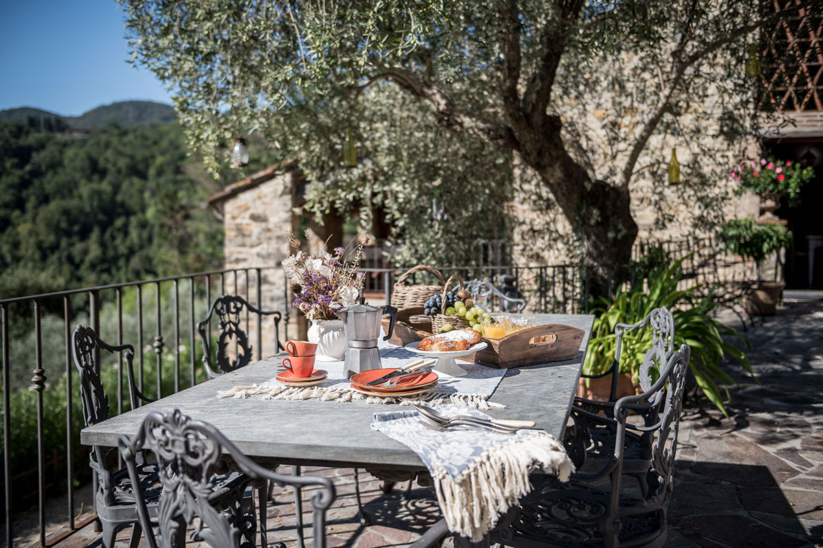 A breakfast spread on the table with stunning tuscan hill views at Al Bastini